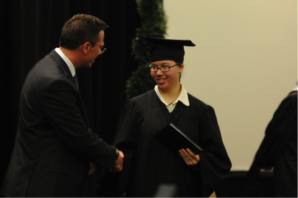Provost Academy Colorado Student of the Year Taylor Willingham receives her diploma.