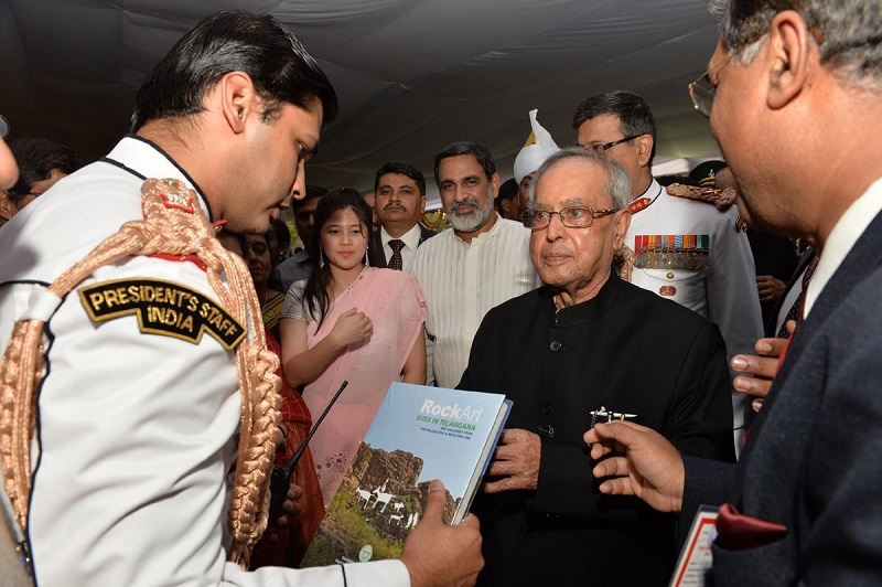 "Mr. BP Acharya, Principal Secretary, Tourism, Culture & Commissioner of I&PR presenting a book on ""Telangana Rock Arts"" published by Department of Archaeology to the President of India Mr. Pranab Mukherjee at Rashtrapathi Nilayam, Bollaram on 07-07-2015."