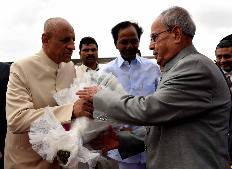 Mr. ESL Narasimhan, Governor of Telangana, bidding farewell to the President of India Mr. Pranab Mukherjee at Hakimpet Airport, Hyderabad on 08-07-2015.