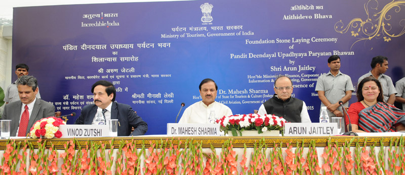 The Union Minister for Finance, Corporate Affairs and Information & Broadcasting, Mr. Arun Jaitley and the Minister of State for Culture (Independent Charge), Tourism (Independent Charge) and Civil Aviation, Dr. Mahesh Sharma at the foundation stone laying ceremony of the new building of Tourism Ministry 'Paryatan Bhawan', on the occasion of the World Tourism Day, in New Delhi on September 27, 2015. The Secretary of Tourism, Mr. Vinod Zutshi and other dignitaries are also seen.