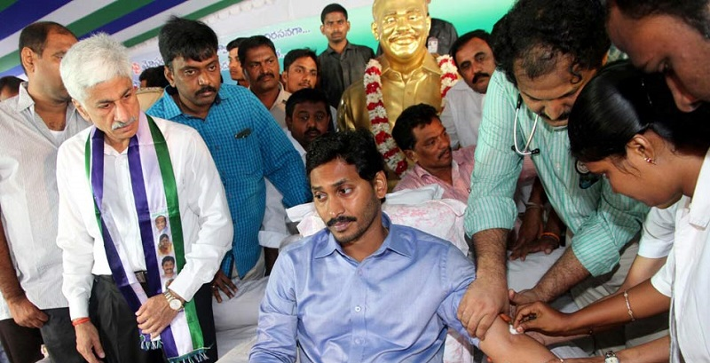 Doctors examining Mr. YS Jagan Mohan Reddy's pulse rating during his on-going indefinite hunger-strike in Nallapadu, Guntur on 11-10-2015. (Picture Source: Saakshi)