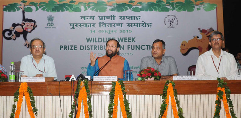 The Minister of State for Environment, Forest and Climate Change (Independent Charge), Mr. Prakash Javadekar addressing at the Prize distribution function of Wildlife Week, in New Delhi on October 14, 2015. The Secretary, Ministry of Environment, Forest and Climate Change, Mr. Ashok Lavasa and other dignitaries are also seen.