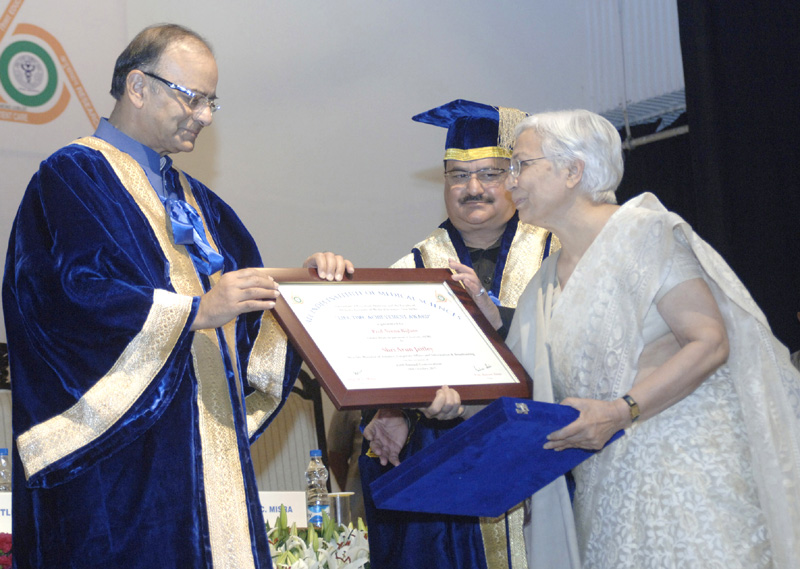 The Union Minister for Finance, Corporate Affairs and Information & Broadcasting, Mr. Arun Jaitley gave away the Lifetime Achievement Award to former senior faculty member, at the 43rd Annual Convocation of AIIMS, in New Delhi on October 18, 2015. The Union Minister for Health & Family Welfare, Mr. J.P. Nadda is also seen.