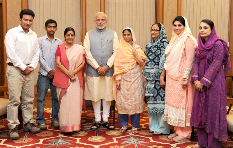 Ms. Geeta, a differently-abled Indian woman who accidentally crossed over to Pakistan, a decade ago, meeting the Prime Minister, Mr. Narendra Modi after her return to India, in New Delhi on October 26, 2015. The Union Minister for External Affairs and Overseas Indian Affairs, Mrs. Sushma Swaraj is also seen.