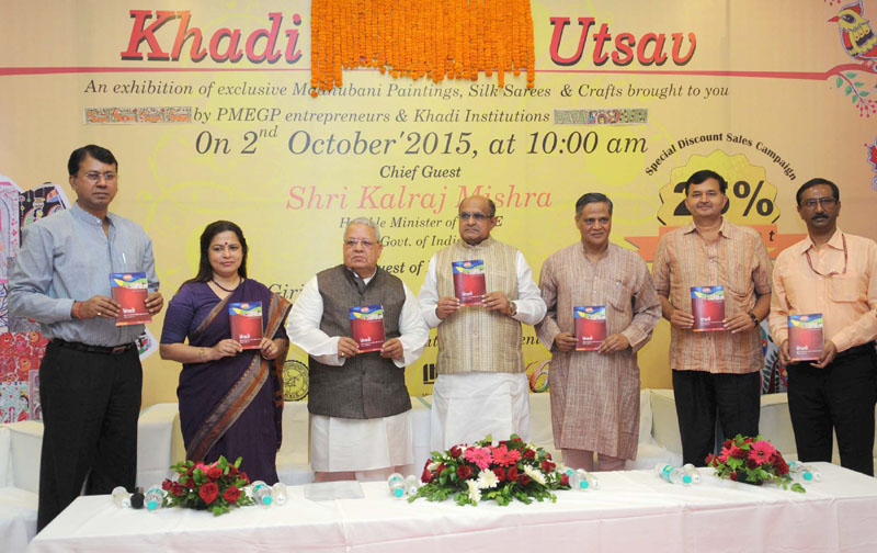 """The Union Minister for Micro, Small and Medium Enterprises, Mr. Kalraj Mishra releasing the publication at the launch of the Special Sales Campaign and """"Khadi Utsav"""", on the occasion of Gandhi Jayanti, in New Delhi on October 02, 2015. The Secretary, Ministry of Micro, Small & Medium Enterprises, Dr. Anup K. Pujari AND other dignitaries are also seen."""