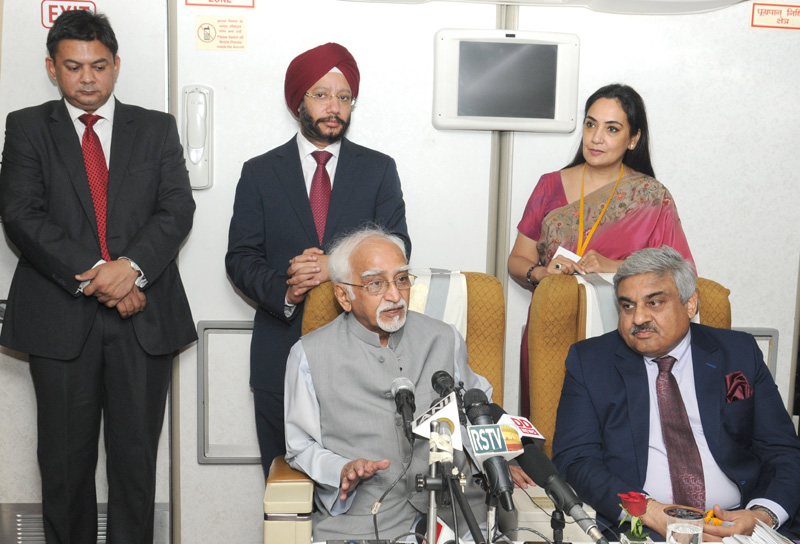 The Vice President, Mr. Mohd. Hamid Ansari addressing a press conference onboard Special Air India flight enroute to Indonesia, on November 01, 2015.