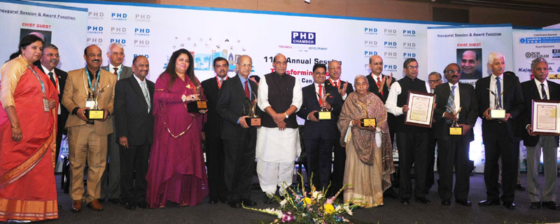 The Union Home Minister, Mr. Rajnath Singh with the recipients of the PHD Annual Awards for Excellence 2015, at the inauguration of the 110th Annual Session of the PHD Chamber, in New Delhi on November 28, 2015.