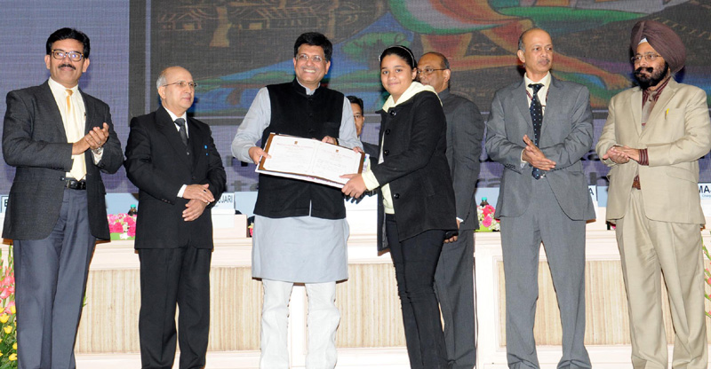 The Minister of State (Independent Charge) for Power, Coal and New and Renewable Energy, Mr. Piyush Goyal presented the National Painting Competition Prizes, at the National Energy Conservation Day function, in New Delhi on December 14, 2015. The Secretary, Ministry of Power, Mr. P.K. Pujari and other dignitaries are also seen.