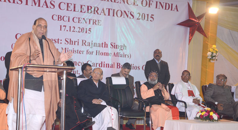 The Union Home Minister, Mr. Rajnath Singh addressing the gathering at the Christmas celebrations under the auspices of the Catholics Bishops' Conference of India (CBCI), in New Delhi, on December 17, 2015. The Deputy Chairman of the Rajya Sabha Prof. P.J. Kurien and other dignitaries are also seen.