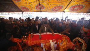 Senior leaders of Nepali Congress party lay the party flag on the body of late former Prime Minister Sushil Koirala in Kathmandu, Nepal, February 9, 2016. REUTERS/Navesh Chitrakar