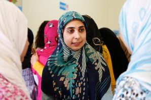 A_Lebanese_woman_talks_to_two_Syrian_refugee_girls_at_an_information_session_about_gender-based_violence_and_early_marriage_in_southern_Lebanon_(14496198189)