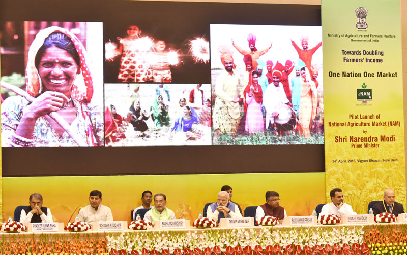 The Prime Minister, Mr. Narendra Modi at the launching ceremony of e-NAM – the e-trading platform for the National Agriculture Market, in New Delhi on April 14, 2016. The Union Minister for Agriculture and Farmers Welfare, Mr. Radha Mohan Singh, Union Minister for Communications & Information Technology, Mr. Ravi Shankar Prasad, the Ministers of State for Agriculture and Farmers Welfare, Dr. Sanjeev Kumar Balyan and Mr. Mohanbhai Kalyanjibhai Kundariya and other dignitaries are also seen.