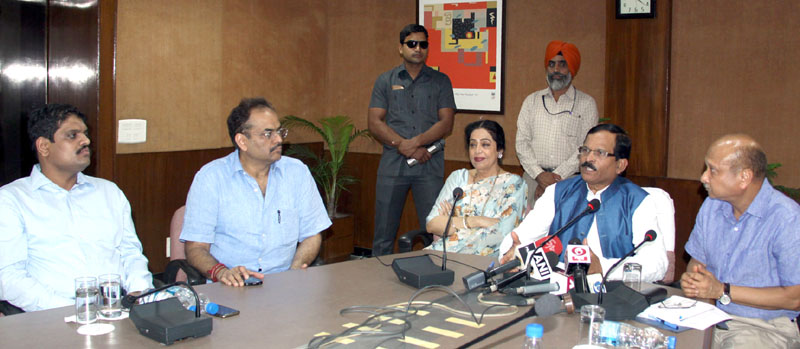 The Minister of State for AYUSH (Independent Charge) and Health & Family Welfare, Mr. Shripad Yesso Naik, the Member of Parliament, Chandigarh, Mrs. Kirron Kher and the Secretary, AYUSH, Mr. Ajit M. Sharan addressing the press conference regarding the arrangements for the 'International Day of Yoga-2016', in Chandigarh on June 10, 2016.