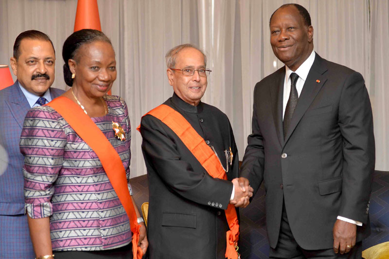 The President, Mr. Pranab Mukherjee being honoured with the National Order of the Cote d'Ivoire, the highest civilian award of the West African country, by the President of the Republic of Cote d'Ivoire, Mr. Alassane Ouattara, at the banquet hosted in his honour, at Presidential Palace, in Abidjan on June 14, 2016. The Minister of State for Development of North Eastern Region (I/C), Youth Affairs and Sports (I/C), Prime Minister?s Office, Personnel, Public Grievances & Pensions, Atomic Energy and Space, Dr. Jitendra Singh is also seen.