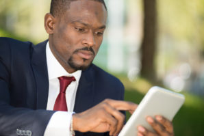 Businessman using his tablet computer