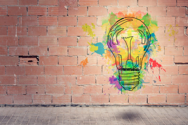 Painted light bulb on a wall