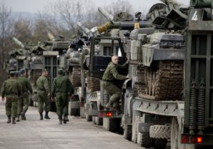 Ukrainian soldiers transport their tanks from their base in Perevalnoe, outside Simferopol, Crimea, Wednesday, March 26, 2014. Ukraine has started withdrawing its troops and weapons from Crimea, now controlled by Russia. (AP Photo/Pavel Golovkin)