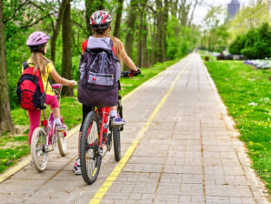Girls riding on a bike lane well away from traffic