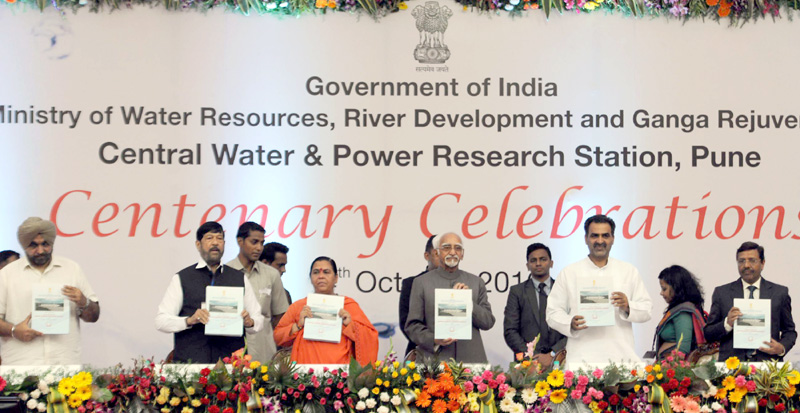 The Vice President, Mr. M. Hamid Ansari releasing the Coffee Table Book 'CWPRS – 100 years and beyond' on the occasion of its Centenary Celebrations, in Pune on October 04, 2016. The Union Minister for Water Resources, River Development and Ganga Rejuvenation, Sushri Uma Bharti, the Minister of State for Water Resources, River Development and Ganga Rejuvenation, Dr. Sanjeev Kumar Balyan and the Minister for Food, Civil Supplies and Consumer Protection, Food and Drugs Administration, Parliamentary Affairs, Maharashtra, Mr. Girish Bapat are also seen.