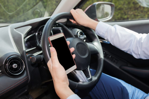 Businessman Checking Phone While Careless Driving - Distraction