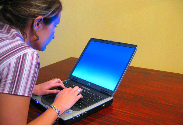 https://commons.wikimedia.org/wiki/File:Woman-typing-on-laptop.jpg