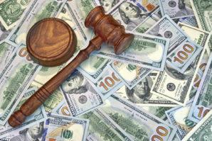 Judges Gavel On The Dollar Cash Background