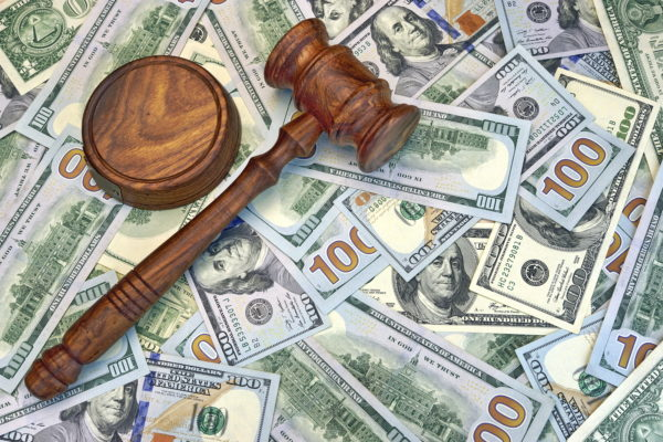 Judges Gavel On The Dollar Cash Background