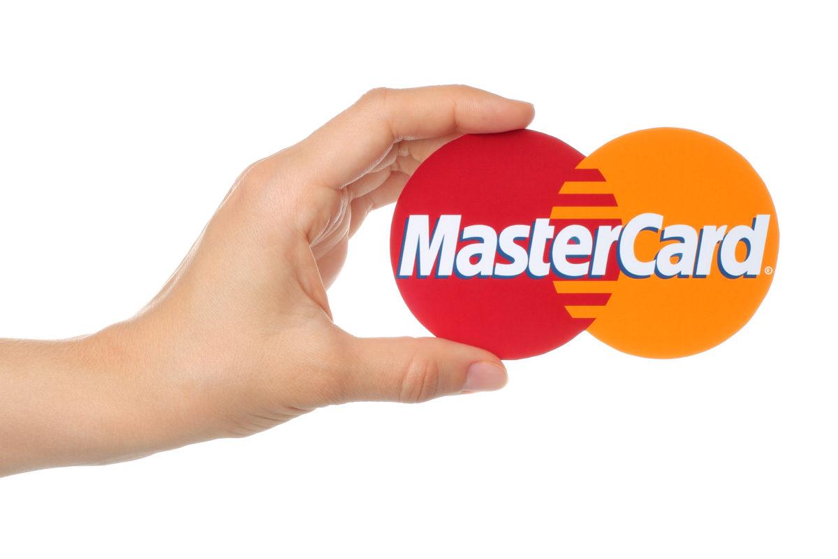 Hand holds Mastercard logo